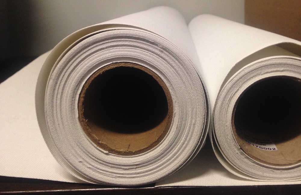 Two rolls of canvas printing paper.