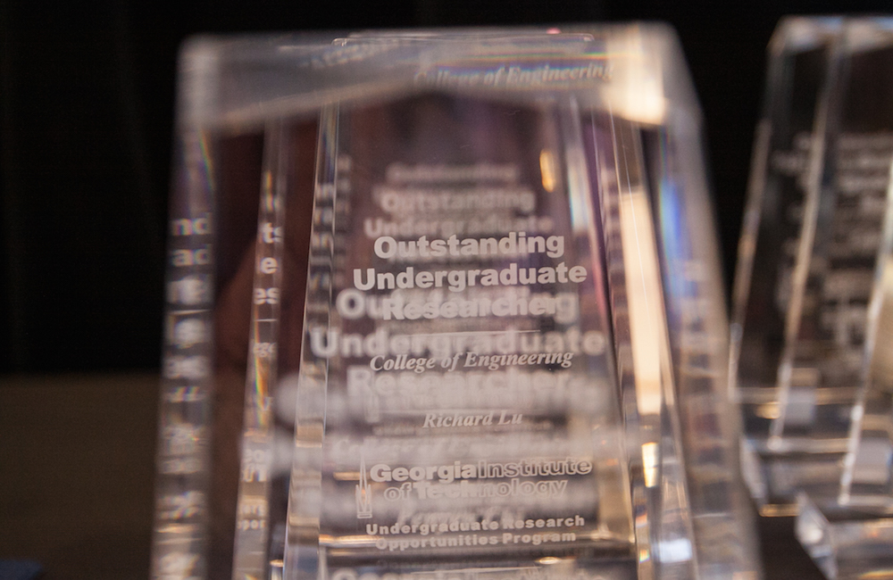Outstanding Undergraduate Researcher trophies lined up.